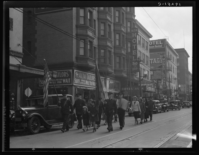 Salvation Army, San Francisco, California. Regular Sunday meeting. (Meeting held regularly Sundays, Tuesdays, Thursdays.) Marching up the street to the meeting