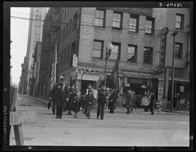 Salvation Army, San Francisco, California. Regular Sunday morning meeting. (Meeting held regularly Sunday, Tuesday and Thursdays.) Marching up street to the meeting