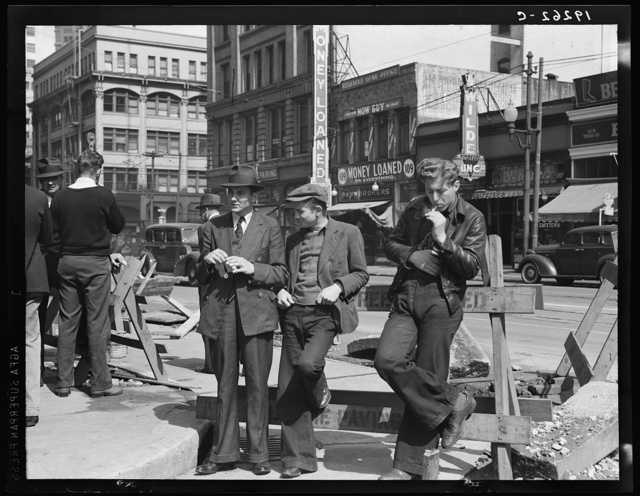Salvation Army, San Francisco, California. Unemployed young men pause a moment to loiter and watch, and then pass on