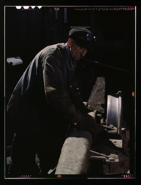 Sam Cell, working on the truck of a car at the rip tracks of C & NW RR's Proviso yard, Chicago, Ill.