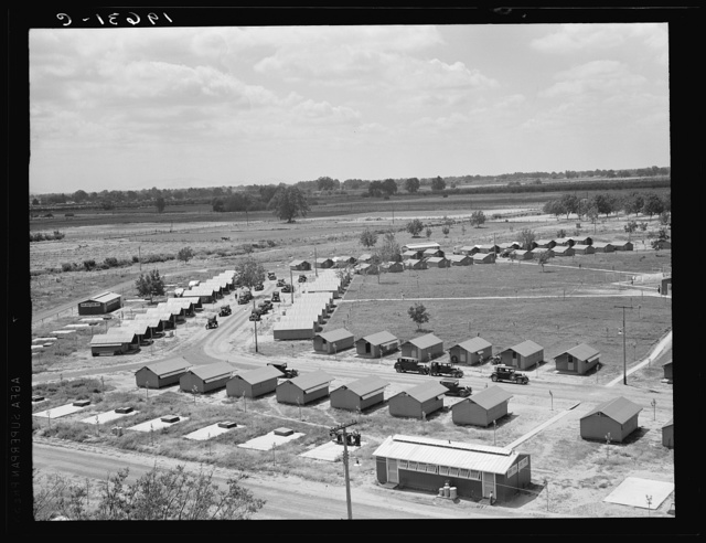 Same as 19635. General view of one end of camp showing three units of the camp, each with its sanitary building. Farmersville, Tulare County, California