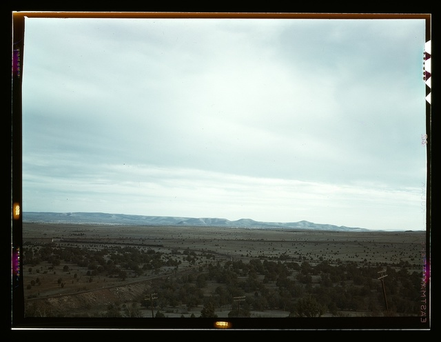 Santa Fe R.R. freight train rounding a curve between Ash Fork and Gleed, Arizona