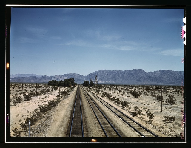 Santa Fe R.R. line leaving Cadiz, Calif. This town is a junction point with a branch going to Phoenix, Ariz.