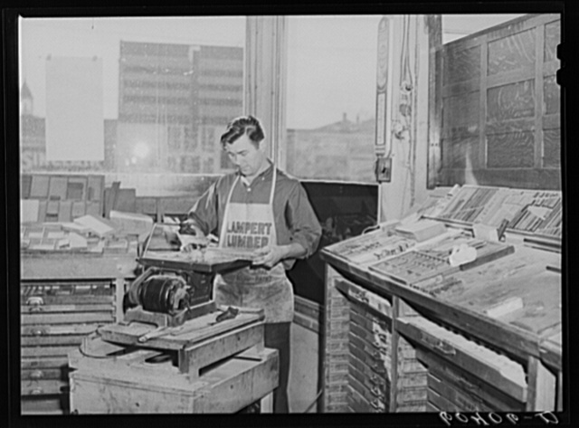 Sawing lead blocks for making cuts. Office of the Valley News. Browns Valley, Minnesota