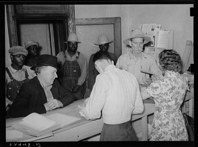 Scene in county agent's office, San Augustine, Texas. Farmer is receiving his AAA check