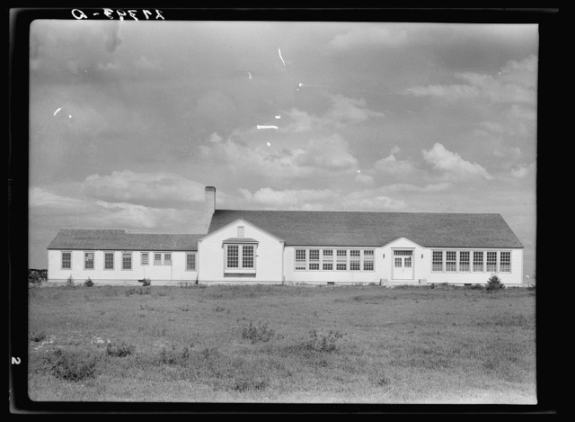 School and community center. Fairfield Bench Farms, Montana