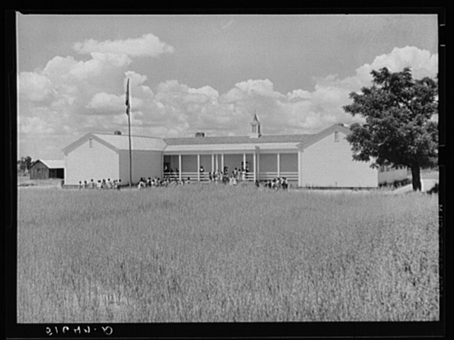 School building, with oats planted in foreground until landscaping can be done. Flint River Farms, Georgia