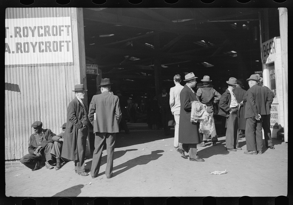 Selling scarves and table covers outside warehouse during tobacco auction, Durham, North Carolina