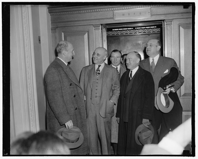 Senate committee quizzes members on government cooperation given French mission. Washington, D.C., Feb. 16. Secretary of Treasury Henry Morgenthau and Secretary of War Harry H. Woodring were today questioned by the Senate Military Affairs Committee concerning the aid they gave a French Mission buying late model American-made fighting planes. Following the hearing Chairman Sheppard announced a transcript of the testimony, excluding what was considered military secrets, would be made public shortly. In the picture, left to right: Secretary Morgenthau, Chairman Andrew J. May of the House Military Affairs Committee; John W. Hanes, Undersecretary of the Treasury; Secretary Woodring; and Assistant Secretary of War Louis Johnson, 2-16-39
