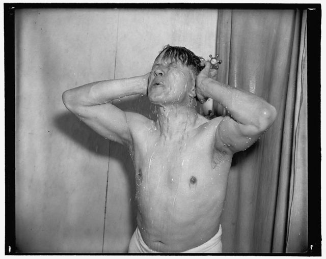 Senator Ellender. Following a round with the rowing machine and medicine ball, he finishes off with a hot shower, gradually tapering off to icy cold. 'Makes me ready to tackle the world,' 3-17-39