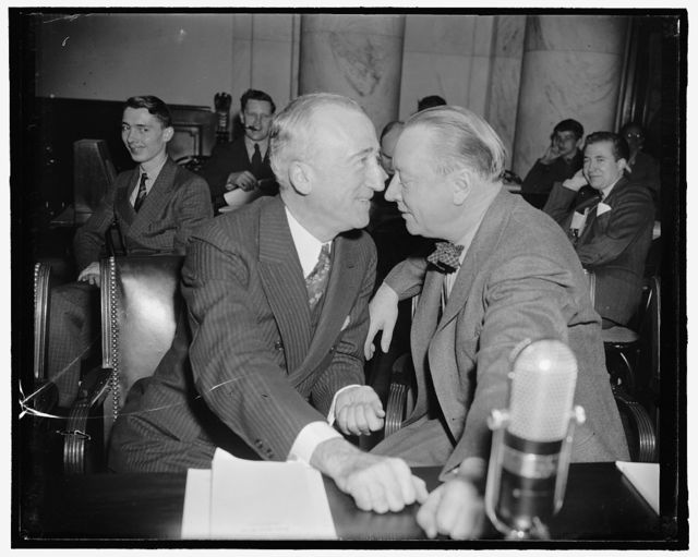 Senatorial huddle. Washington, D.C., April 6. No, this is not a love scene but just one of the frequent huddles into which the two gentlemen from the South - Senator James F. Byrnes, left, of South Carolina, and Senator Robert R. Reynolds of North Carolina - went into while listening to Bernard M. Baruch before The Senate Foreign Relations Committee today. 4-6-39