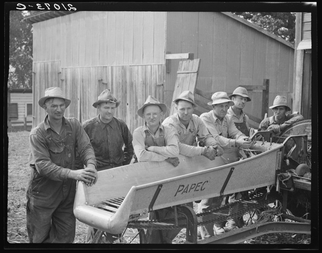 Seven of the eight farmers shown with their cooperatively owned ensilage cutter on the Miller farm, where they are working filling the silo. West Carlton, Yamhill County, Oregon. General caption number 58