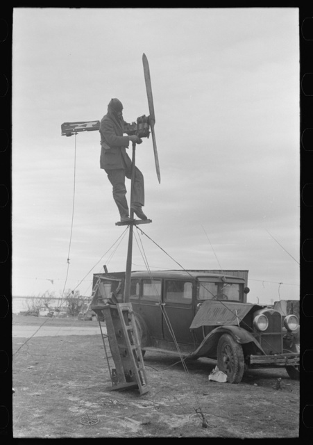 Shrimp fisherman, squatter on Nueces Bay, erecting wind charger for running his radio. Corpus Christi, Texas