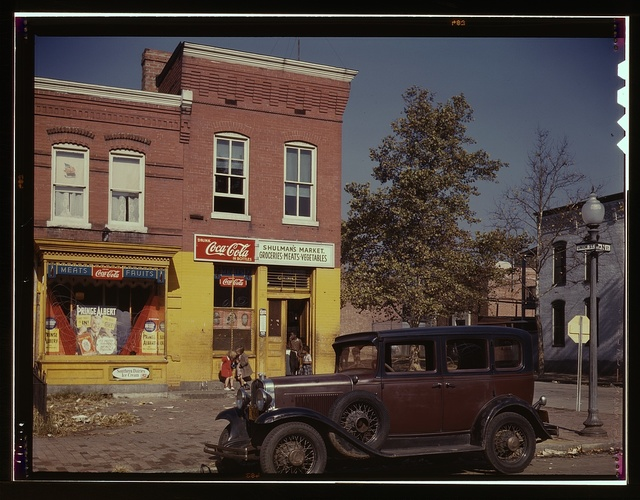 [Shulman's Market at the southeast corner of N Street and Union Street S.W., Washington, D.C., with a 1931 Chevrolet car parked in front]