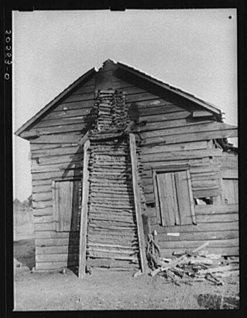 Side view of Negro family's home, showing mud chimney. Near Savannah, Georgia
