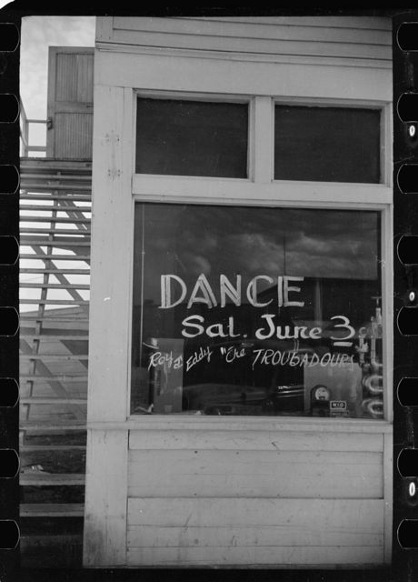 Sign in store window, Fairfield, Montana