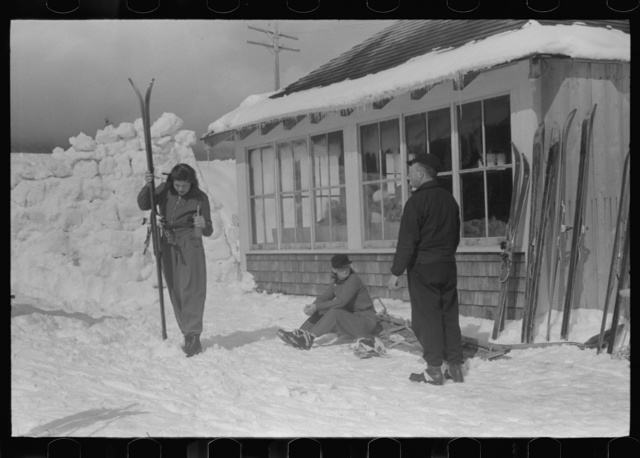 Skiers during noon hour outside of toll house at foot of Mount Mansfield, Smugglers Notch. Near Stowe, Vermont