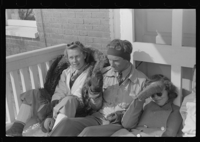Skiers on porch of Mr. Dickinson's home in Lisbon near Franconia, New Hampshire
