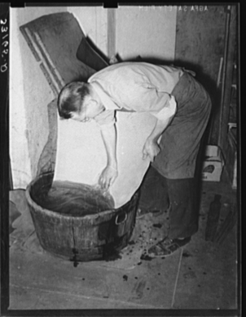 Slack tub. Leather must be moistened and tempered before using for boots. Cowboy bootmaking shop, Alpine, Texas