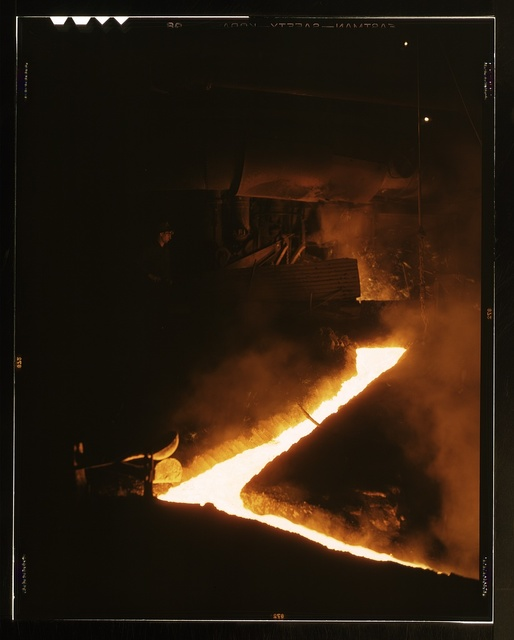 Slag run-off from one of the open hearth furnaces of a steel mills, Republic Steel Corp., Youngstown, Ohio. Slag is drawn off the furnace just before the molten steel is poured into ladles for ingotting