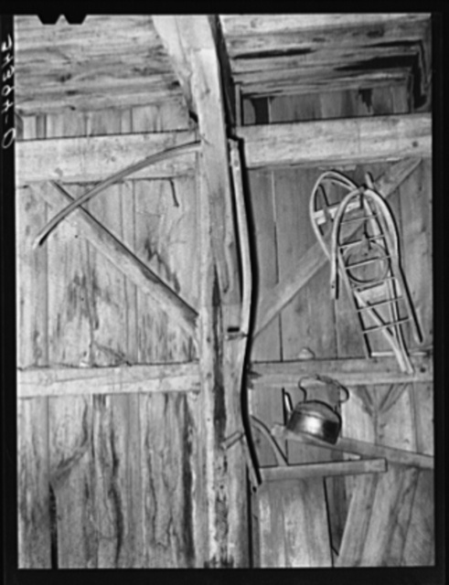 Snowshoes and scythe in barn in Orange County near Bradford, Vermont