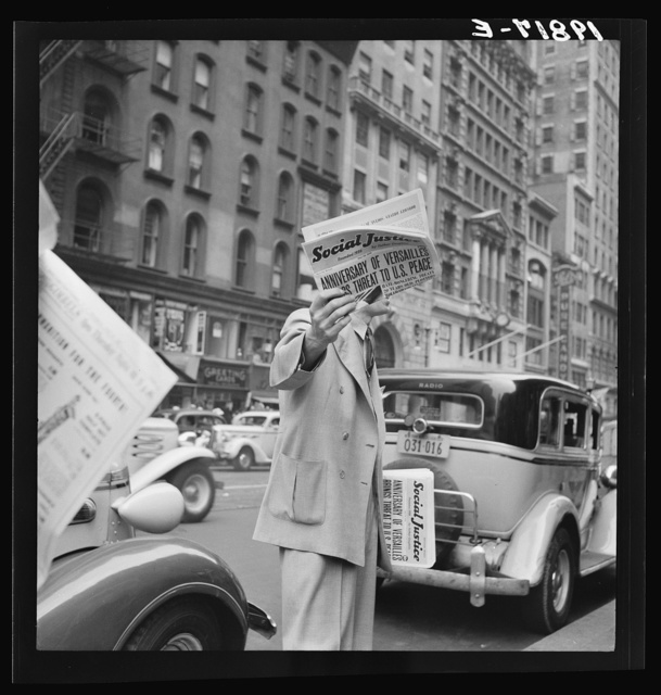 """""""Social Justice,"""" founded by Father Coughlin, sold on important street corners and intersections. New York City"""