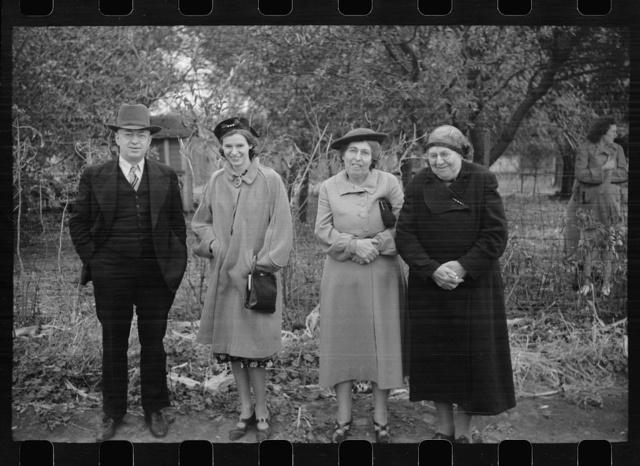 Spectators at cornhusking contest, Marshall County, Iowa