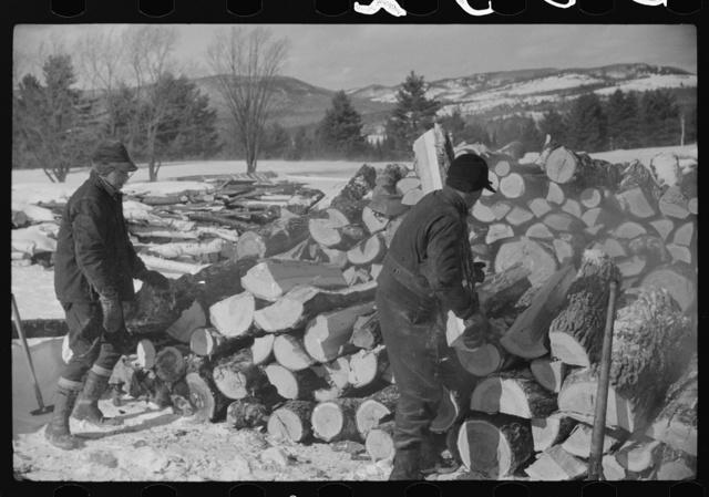 Splitting wood for winter fuel on farm near Littleton, New Hampshire