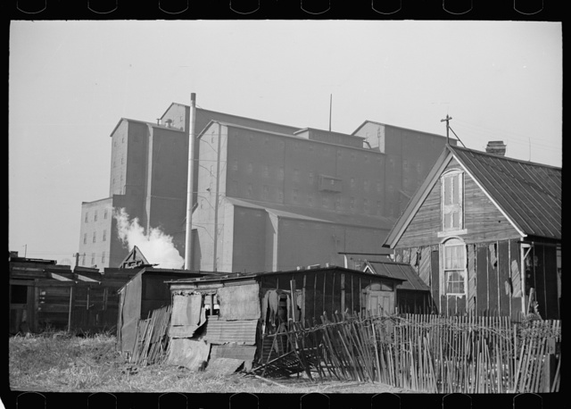Squatters' shacks with grain elevator in background, Saint Louis, Missouri