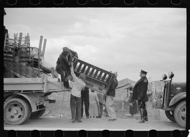 State highway officials moving evicted sharecroppers away from roadside to area between the levee and the Mississippi River, New Madrid County, Missouri