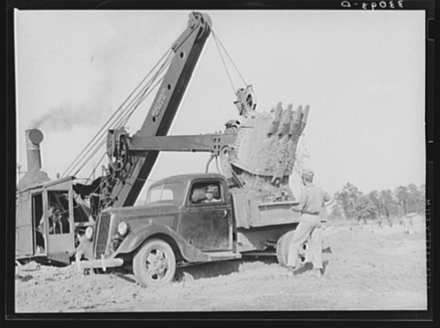 Steam shovel at work at paper mill. Lufkin, Texas