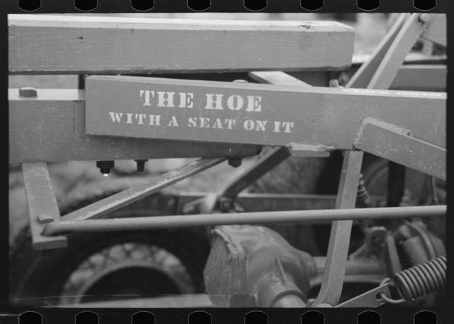 Stencil on Dixie cotton chopper, Delhi, Louisiana