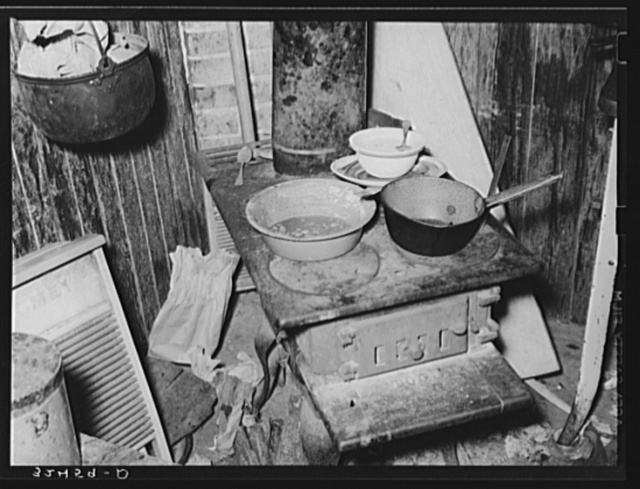 Stove and other articles in kitchen of Mexican living in San Antonio, Texas