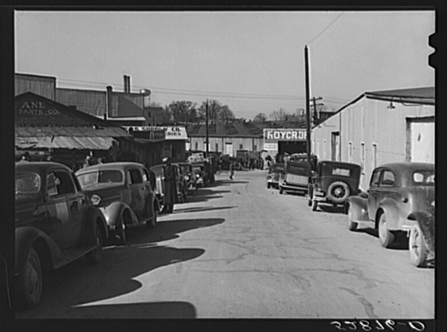 Street in warehouse district during tobacco auction sales. Durham, North Carolina