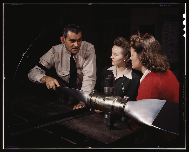 Students at Washington High School at class, training for specific contributions to the war effort, Los Angeles, Calif. Ralph Angar, instructor, explains propeller characteristics to student[s] in the aeronautics class