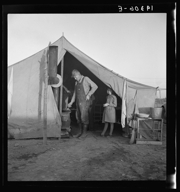 Supper time in Farm Security Administration (FSA) migratory emergency camp for workers in the pea fields. Calipatria, California