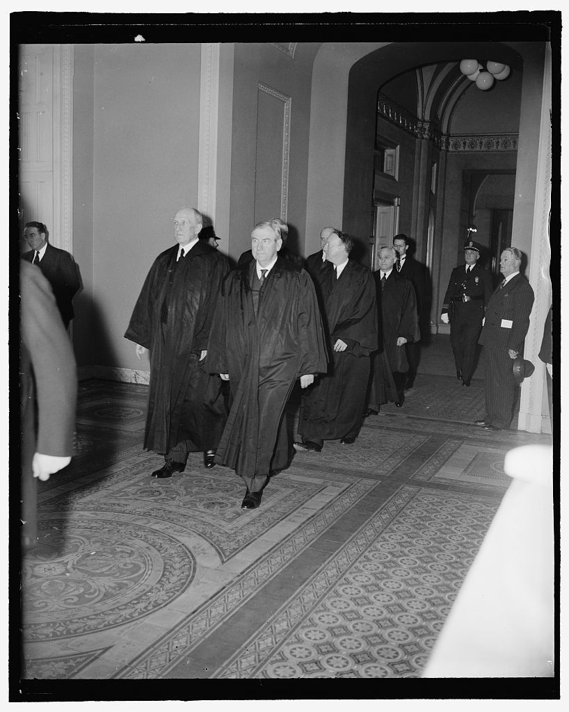 Supreme Court attends funeral services for late Illinois Senator. Washington, D.C., April 12. Members of the U.S. Supreme Court as they arrived for the funeral services for the late Senator J. Ham Lewis in the Senate chamber today. In the picture can be Justices Harlan F. Stone, James Clark Reynolds, Hugo L. Black and Felix Frankfurter . 4-12-39