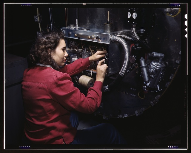 Switch boxes on the firewalls of B-25 bombers are assembled by women workers at North American [Aviation, Inc.]'s Inglewood, Calif., plant
