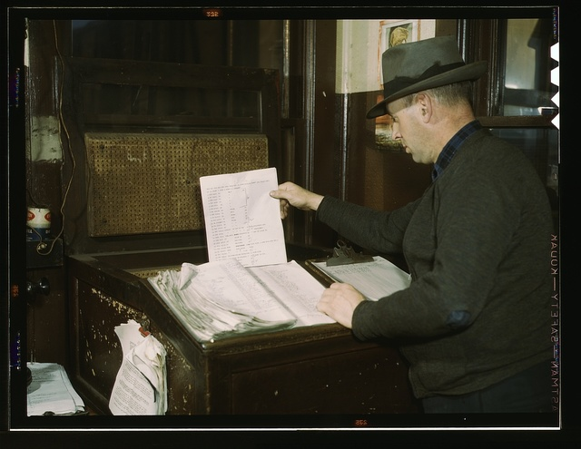 Switch lists coming in by teletype to the hump office at a Chicago and Northwestern railroad yard, Chicago, Ill.