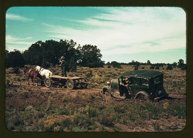 Team pulling a car out of the mud; the roads near Pie Town, New Mexico are not improved