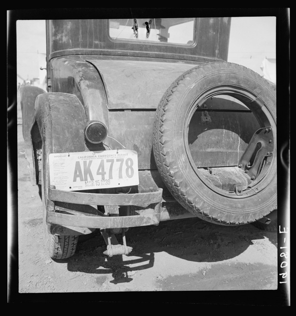Temporary auto license. A common sight in migratory labor camps. Many enter California after cotton picking in Arizona without sufficient money to buy license plates. California