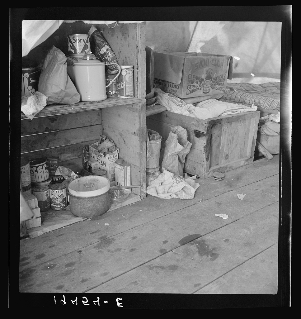 Tent interior in a pea pickers' camp. Food supply and household equipment.  Santa Clara County, California