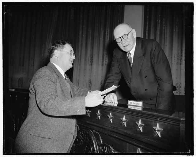 Texas Representative talk on his pension bill. Washington, D.C., Feb. 3. Representative Wright Patman, Texas, shown here with Robert L. Doughton, Chairman of the House Ways and Means Committee, today briefly told the committee of his bill, H.R. 105, introduced Jan. 3, to provide $30 a month to eligible people over 65, from federal funds. Patman was followed by Arthur Johnson, President of the General Welfare Federation of America, 2-3-39
