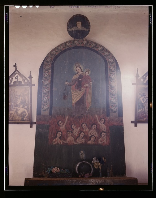 The altar of Nuestra Senora del Carmel on the south wall of the church, Trampas, N.M.