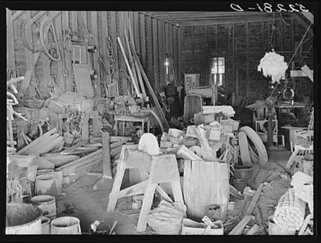 The blacksmith and carpentry shop on Marcella Plantation, Mileston, Mississippi Delta. At the right is a piece of cotton hanging up which Uncle George the blacksmith who has lived there fifty years keeps for good luck. Mississippi