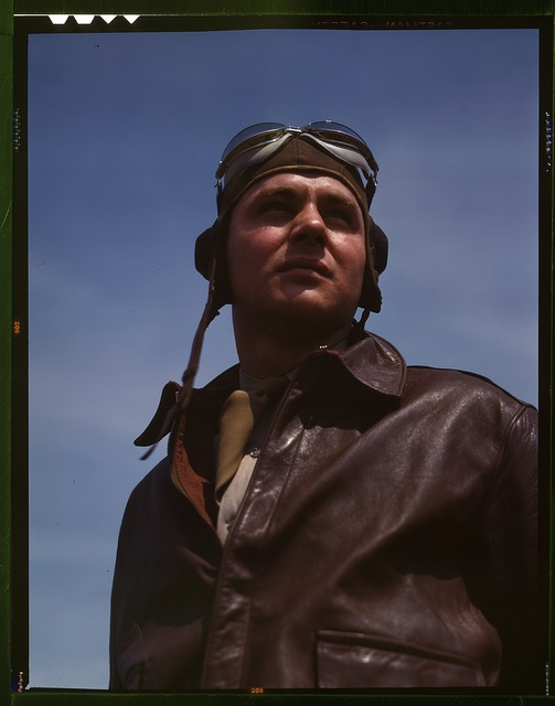 The kind of man Hitler wishes we didn't have. A bomber pilot, captain in a bombardment squadron, just before he climbs aboard his huge YN-17 bombing plane