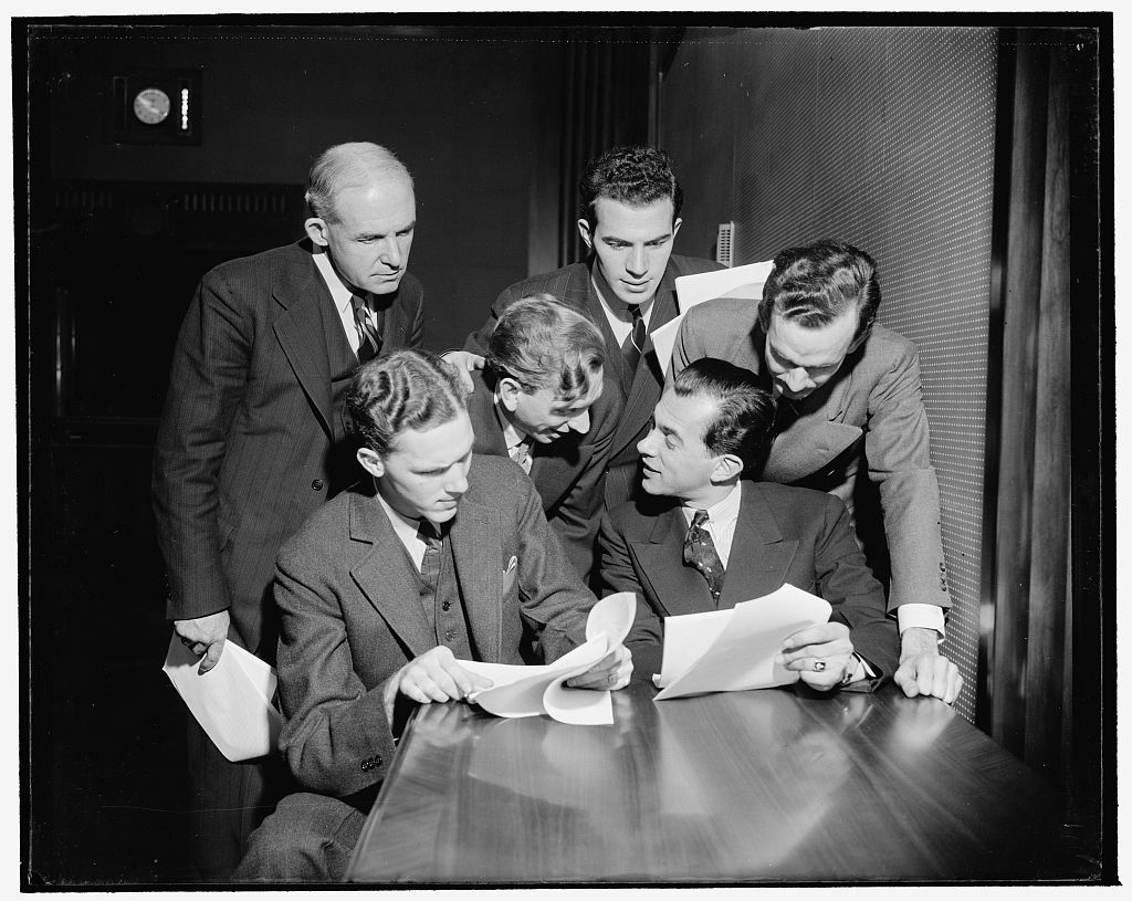The penthouse studio for radio broadcasts on the roof of the Interior Building consists of reception room, office, script writers' room, small and large studios, and sound control room. These actors are members of the cast for My Dear Mr. President, a play based upon the President's budget message [i.e Interior Secretary's annual report] presented in January 1939 through the channels of the national hookups