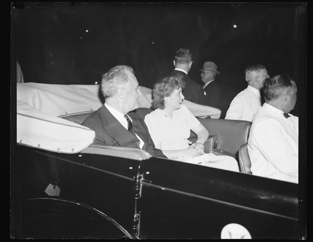 THE PRESIDENT AND WIFE OF AIDE ENJOY OPEN AIR CONCERT ON POTOMAC. WASHINGTON, D.C. JULY 12. THE PRESIDENT AND MRS. EDWIN M. WATSON, WIFE OF THE PRESIDENT'S AIDE, SITTING IN THE PRESIDENTIAL CAR LISTENING TO THE WASHINGTON SYMPHONY ORCHESTRA UNDER THE DIRECTION OF DR. HANS KINDLER AS THE ORCHESTRA PLAYED FROM ITS BARGE ON THE POTOMAC RIVER NEAR THE LINCOLN MEMORIAL. THE OPEN-AIR CONCERTS, WHICH BEGAN TONIGHT, WILL BE CONDUCTED TWICE A WEEK DURING THE SUMMER SEASON, AND WASHINGTONIANS TURN OUT TO SIT ON THE STEPS OR IN NEARBY BOATS TO LISTEN