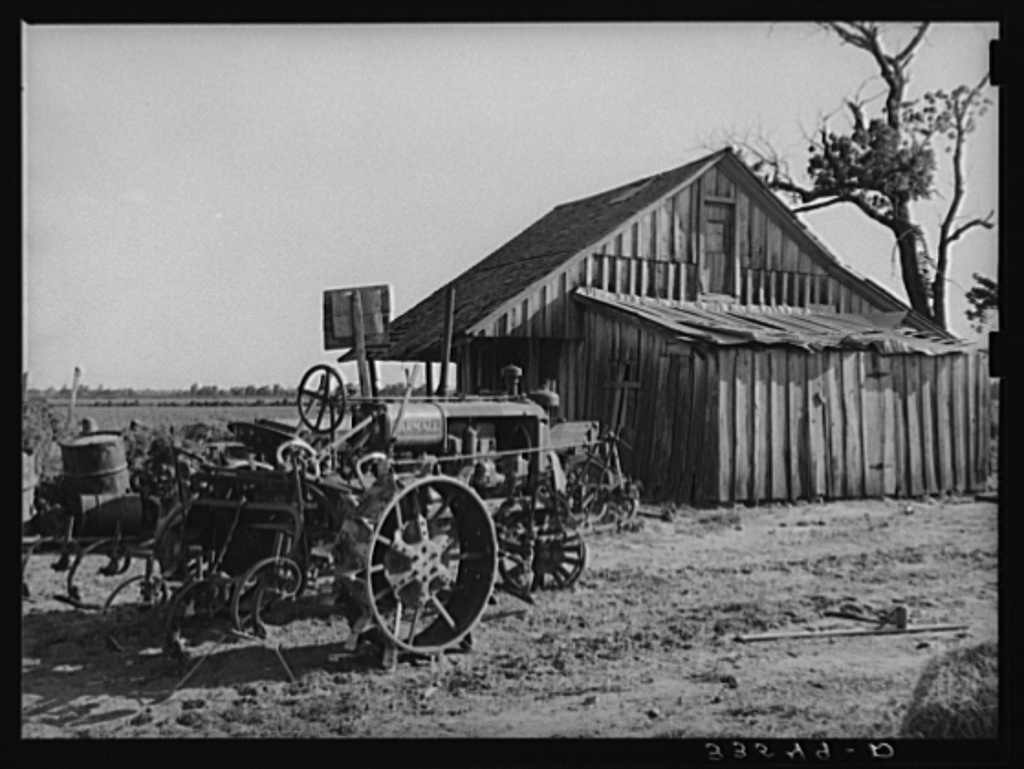 The tractor and home of a man who at one time was a tenant farmer but who is now a day laborer. Wagoner County, Oklahoma