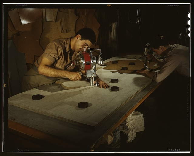 The utmost precision is required of these operators who are cutting and drilling parachute packs in an eastern factory, Manchester, Conn. Their work is under constant close supervision. Pioneer Parchute Company
